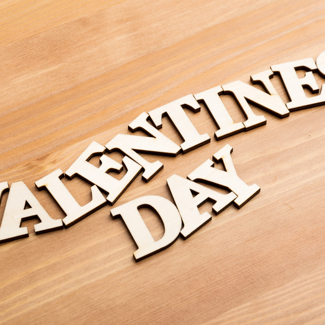 """""""Wooden letters forming phrase Valentines day over wooden background"""" stock image"""
