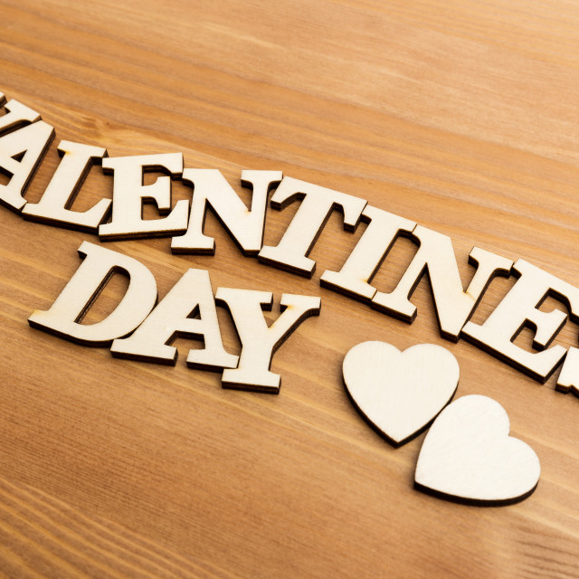 """""""Vintage wooden letters forming phrase Valentines day"""" stock image"""
