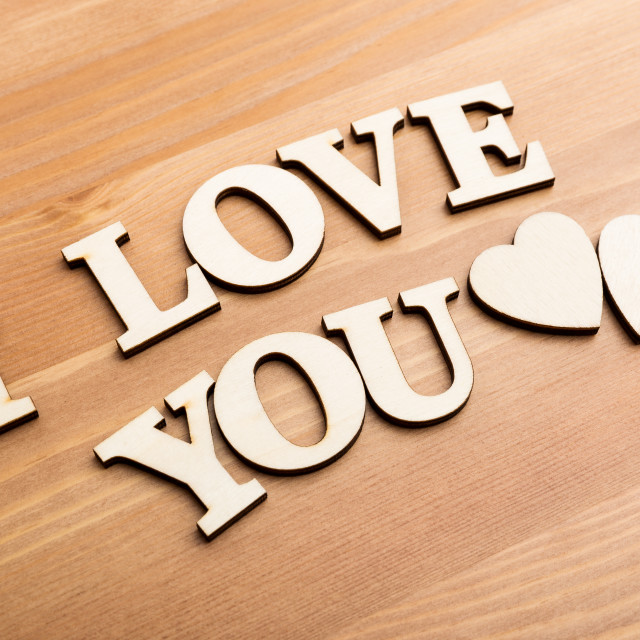 """""""Wooden texture letters forming with phrase I Love You"""" stock image"""