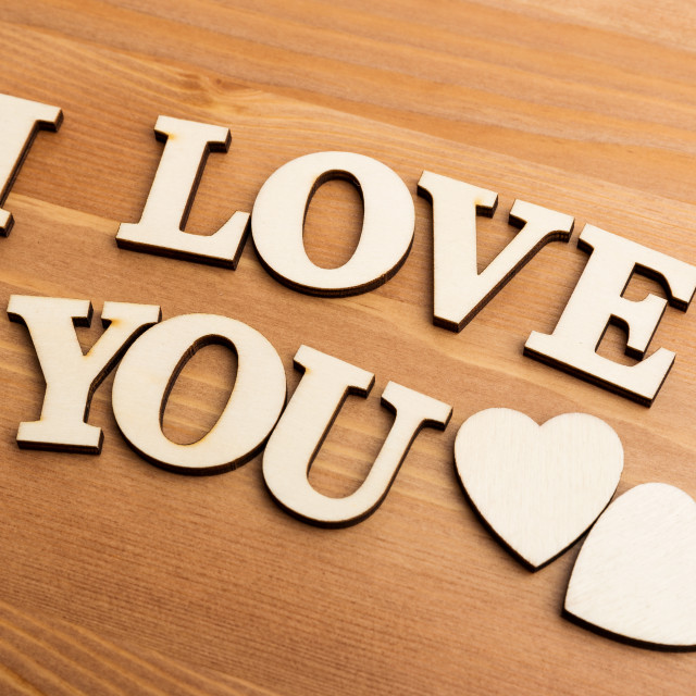 """""""Vintage wooden letters forming with phrase I Love You"""" stock image"""