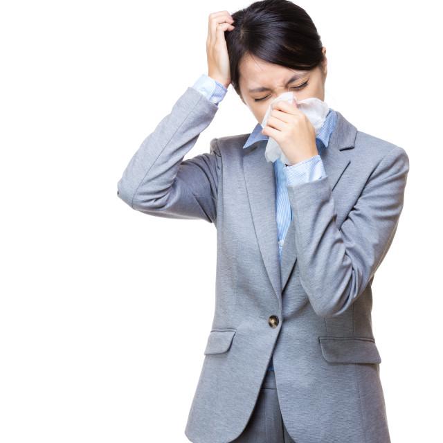 """Businesswoman sneeze and feeeling dizzy"" stock image"