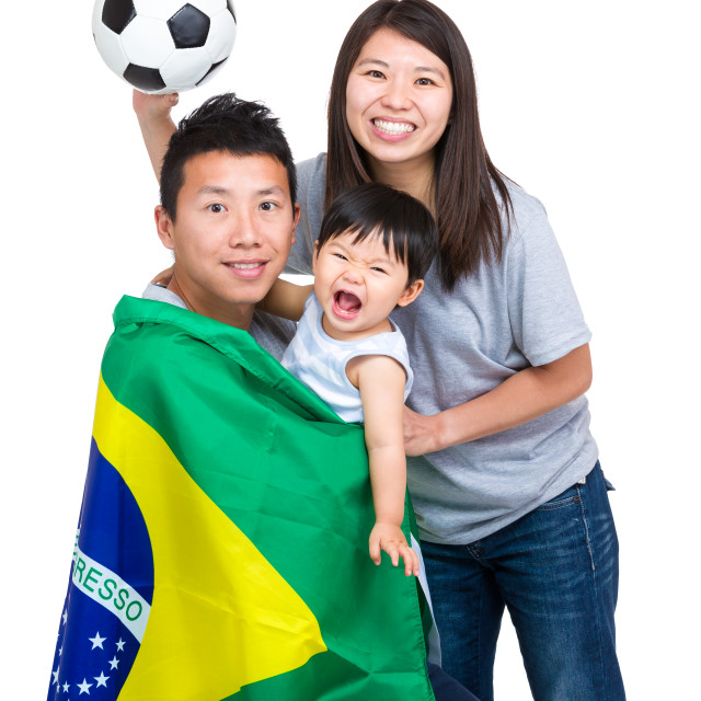 """""""Football supporter of asian family"""" stock image"""