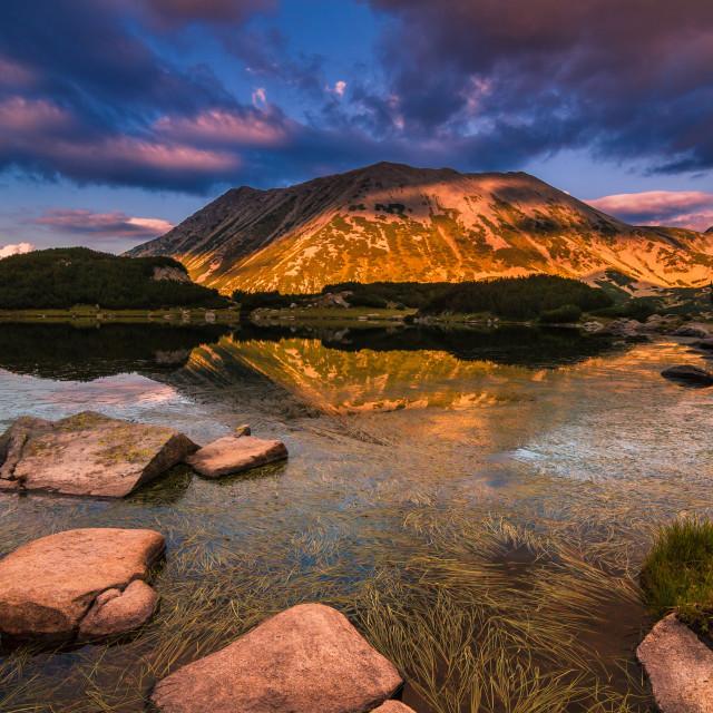 """Mountain lake and high peak"" stock image"