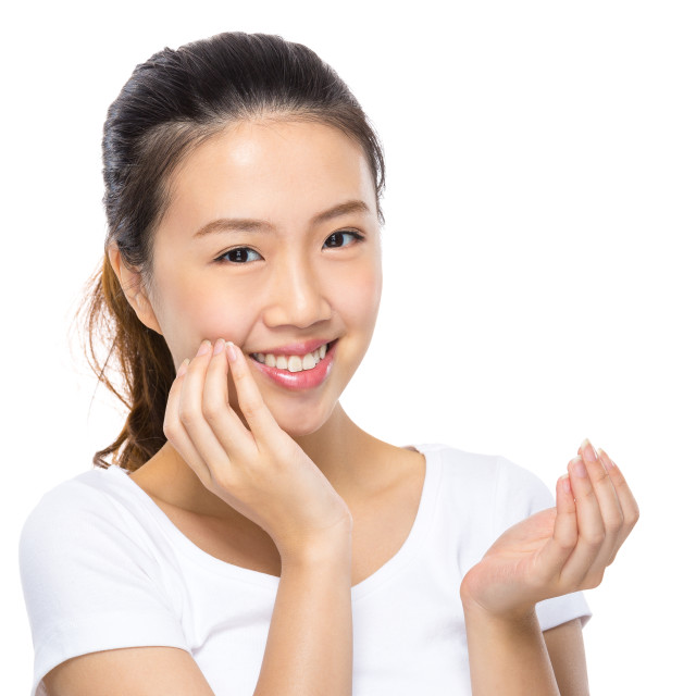 """""""Woman apply skincare on face"""" stock image"""
