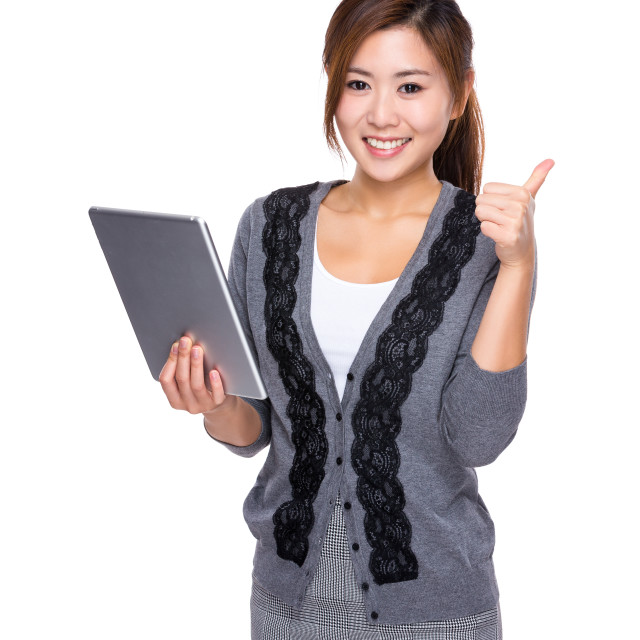 """""""Woman use of digital tablet and thumb up"""" stock image"""