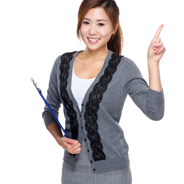 """""""Woman with clipboard and finger up"""" stock image"""
