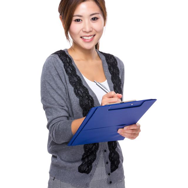 """Asian Woman write on folder"" stock image"