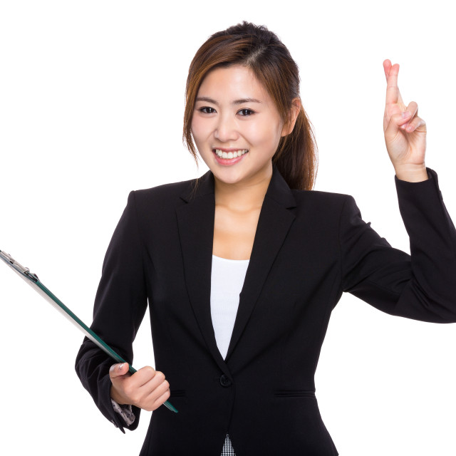 """""""Businesswoman with finger cross and clipboard"""" stock image"""