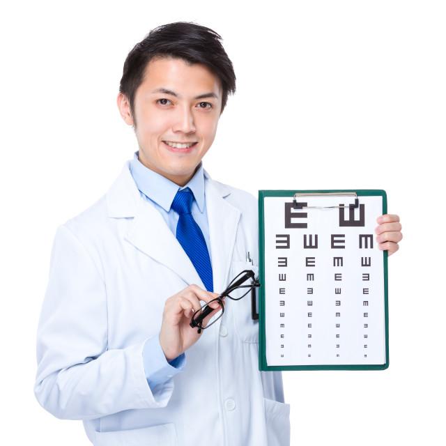 """""""Optician with eyesight test and eyewear"""" stock image"""