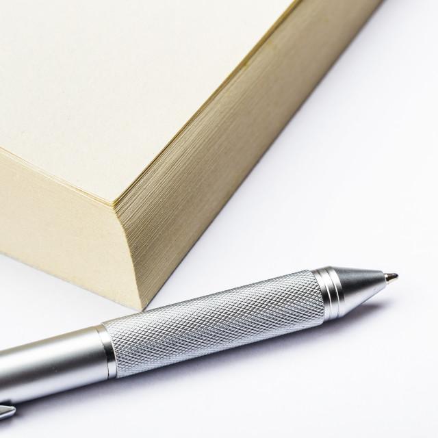 """Memo pad and pen close up"" stock image"
