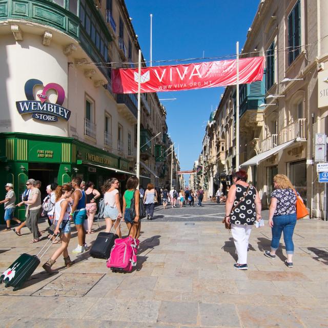 """""""Pedestrians walk in Valletta"""" stock image"""