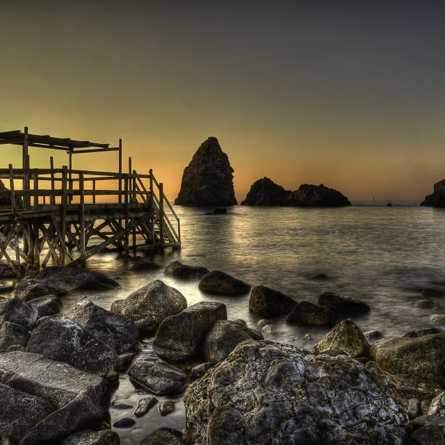 """Aci Trezza (fishing village of Sicily) basaltic rocks"" stock image"