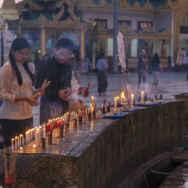 """Burmese Buddhist praying in Schwedagon Pagoda"" stock image"