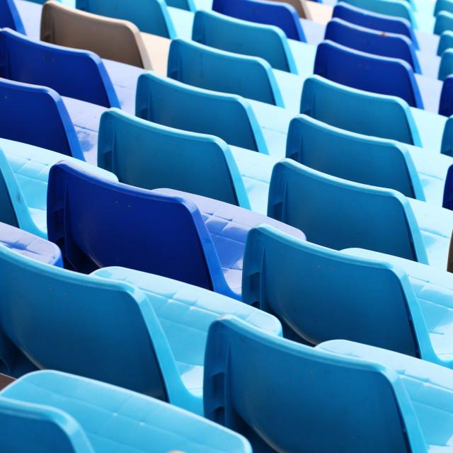 """""""Blue plastic seat in stadium"""" stock image"""