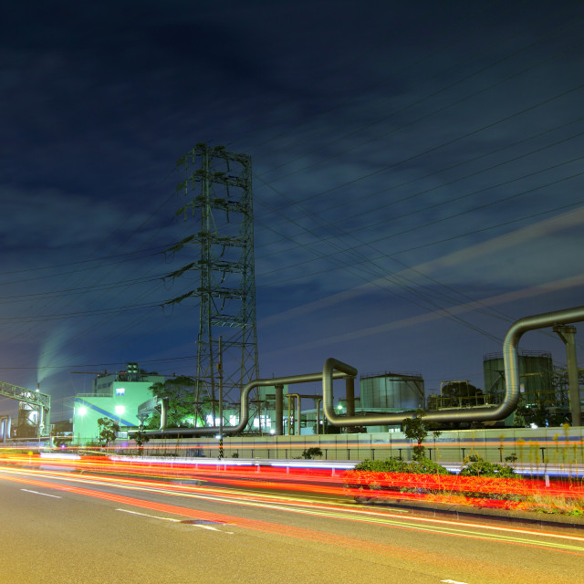 """Industrial complex at night"" stock image"