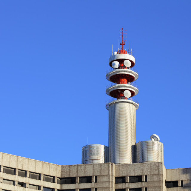 """""""Broadcast tower on building"""" stock image"""