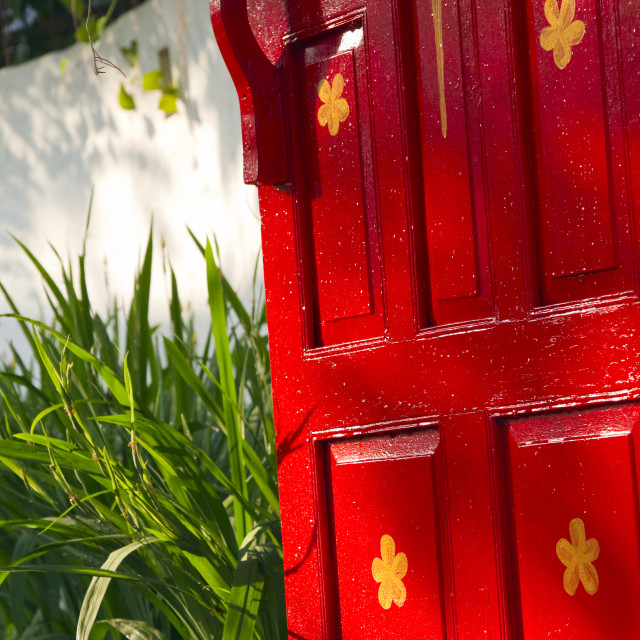 """""""Bright red wooden gate leading to a lush garden"""" stock image"""