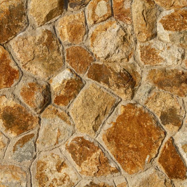 """""""Orange tinted stone wall background"""" stock image"""