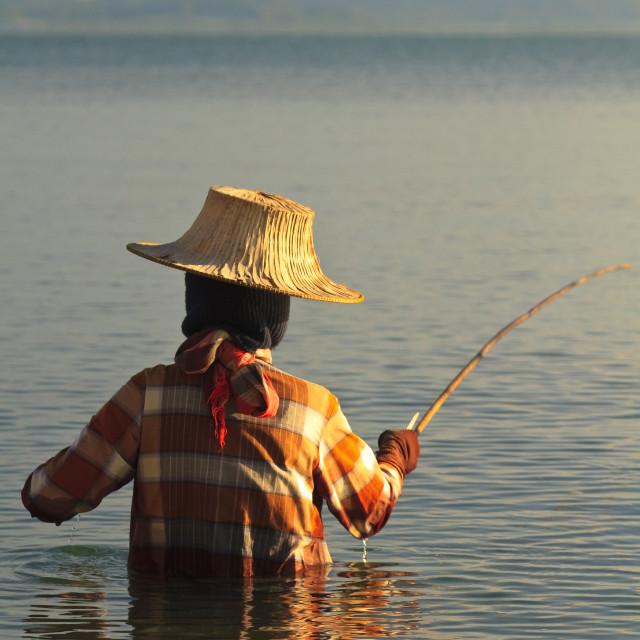 """Thai woman fishing"" stock image"