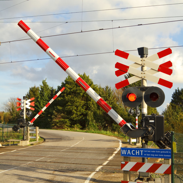 """""""Railroad crossing on a winding road"""" stock image"""