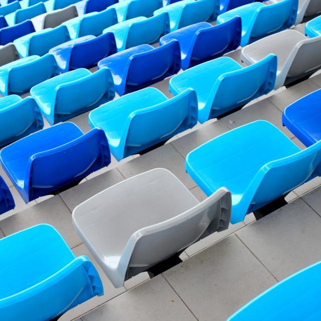"""Blue seats at stadium"" stock image"