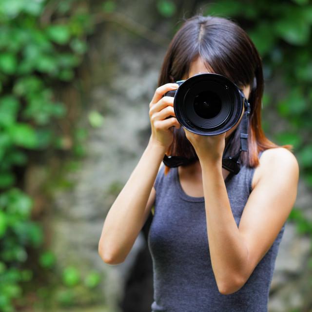"""Asian woman taking photo"" stock image"