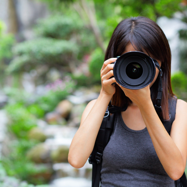 """""""Asian woman taking photo with backpack"""" stock image"""