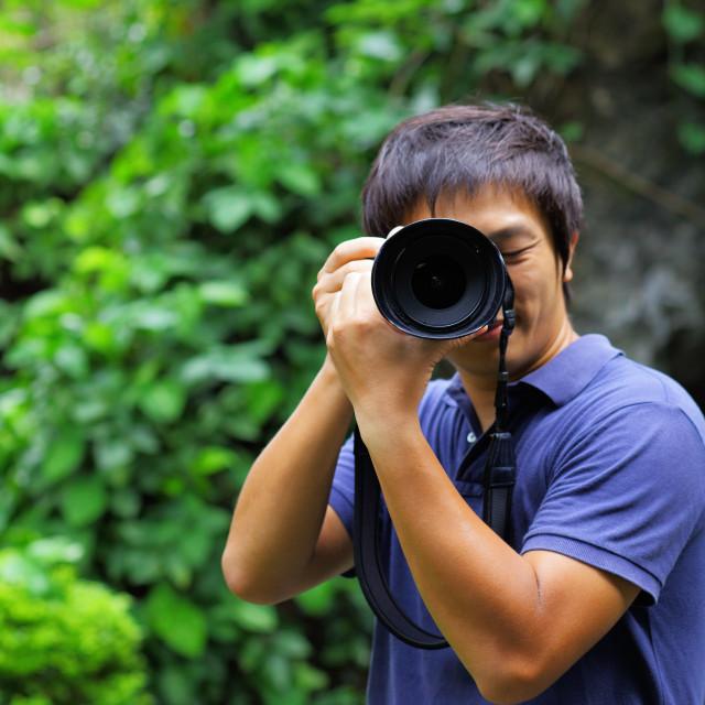 """""""Asian man taking photo"""" stock image"""