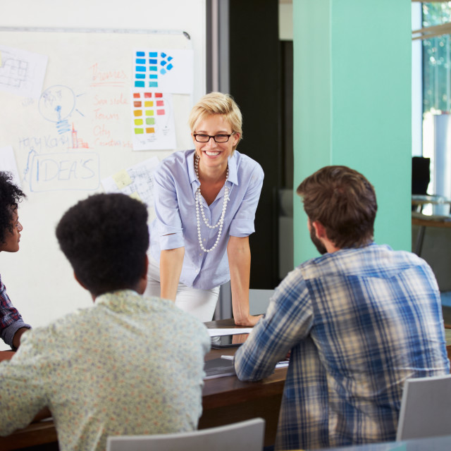 """""""Female Manager Leading Brainstorming Meeting In Office"""" stock image"""