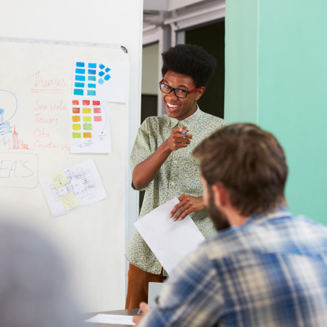 """""""Manager Leading Creative Brainstorming Meeting In Office"""" stock image"""