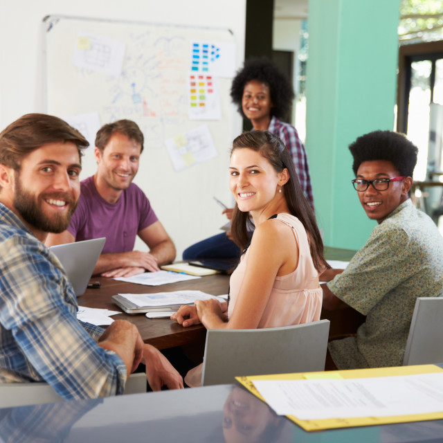 """""""Portrait Of Staff At Brainstorming Meeting In Office"""" stock image"""