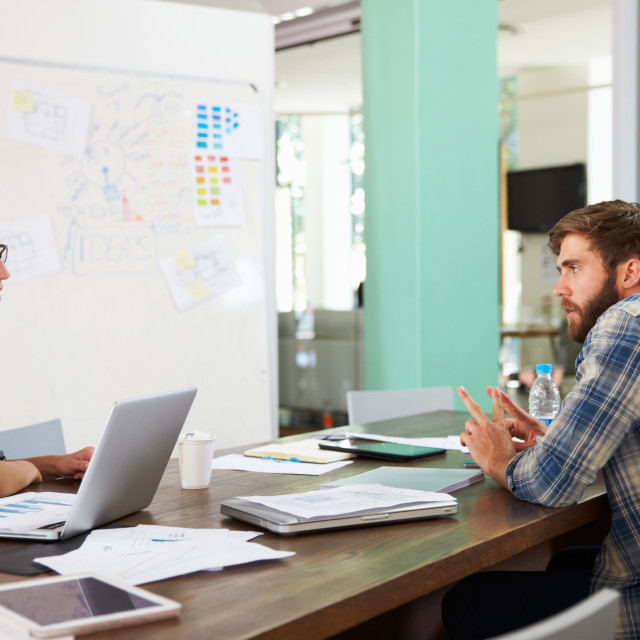 """""""Two Businesspeople Having Creative Meeting In Office"""" stock image"""
