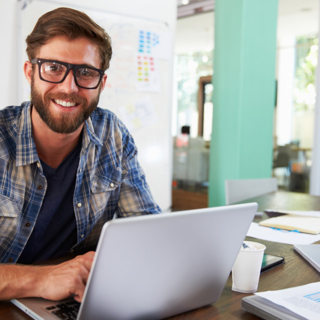 """""""Portrait Of Businessman Working In Creative Office"""" stock image"""