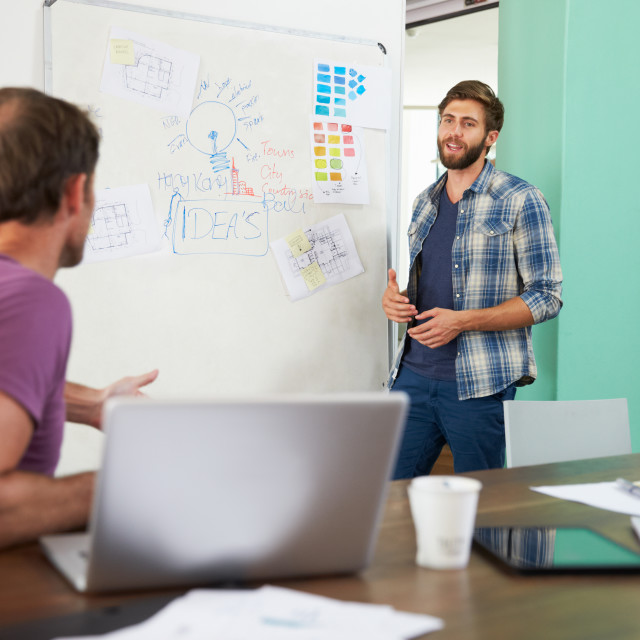 """""""Two Businessmen Having Creative Meeting In Office"""" stock image"""