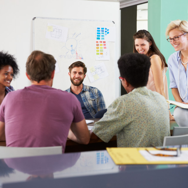 """""""Team Of Businesspeople Having Creative Meeting In Office"""" stock image"""