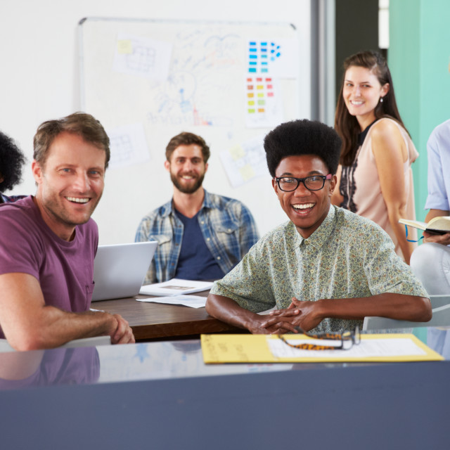"""""""Portrait Of Businesspeople Having Creative Meeting In Office"""" stock image"""