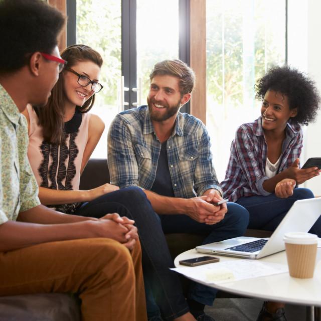 """Businesspeople Having Informal Meeting In Modern Office"" stock image"