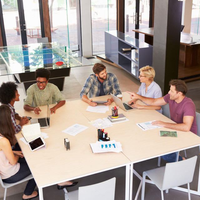 """""""High Angle Of Businesspeople Having Meeting In Modern Office"""" stock image"""