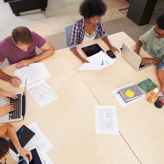 """""""Overhead View Of Creative Brainstorming Meeting In Office"""" stock image"""