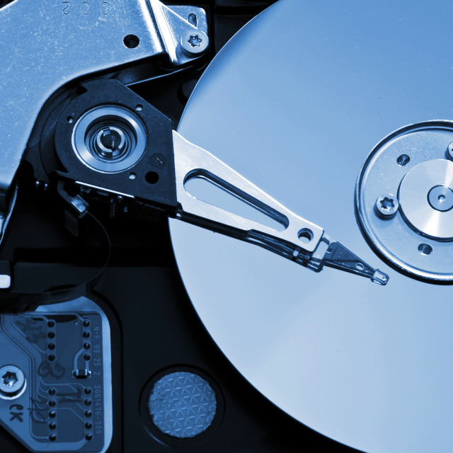 """Close-up of the opened Hard Disk Drive"" stock image"
