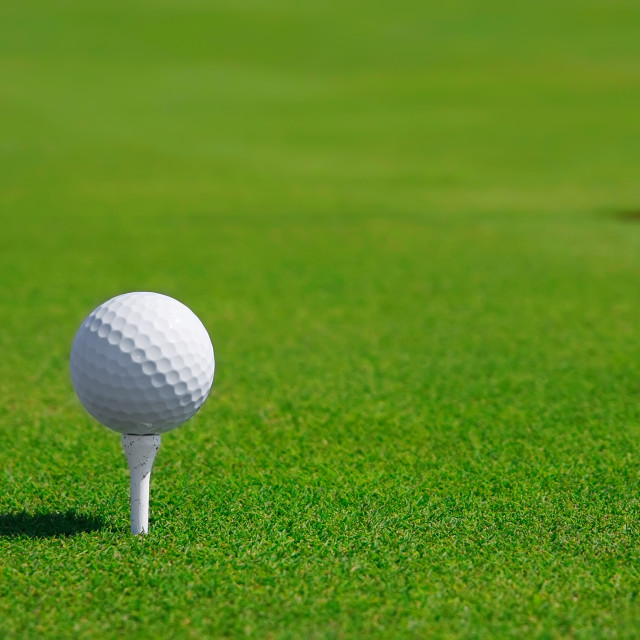 """""""Golf ball in a course and hole"""" stock image"""