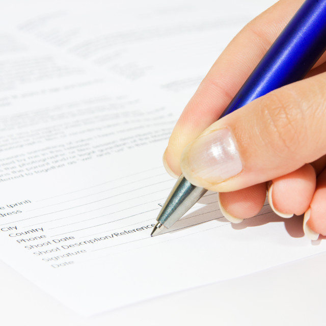 """""""Signing contract closeup. Agreement with woman hand."""" stock image"""