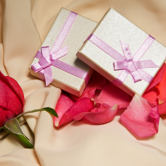 """""""Gift Boxes over satin with rose arrangement."""" stock image"""