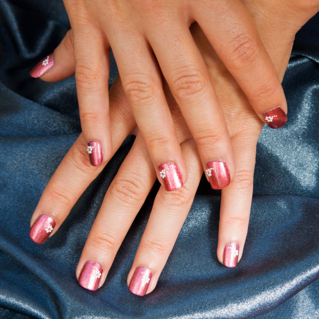 """""""Woman manicure arranged with blue satin"""" stock image"""
