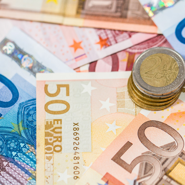 """Euro banknotes and coins"" stock image"