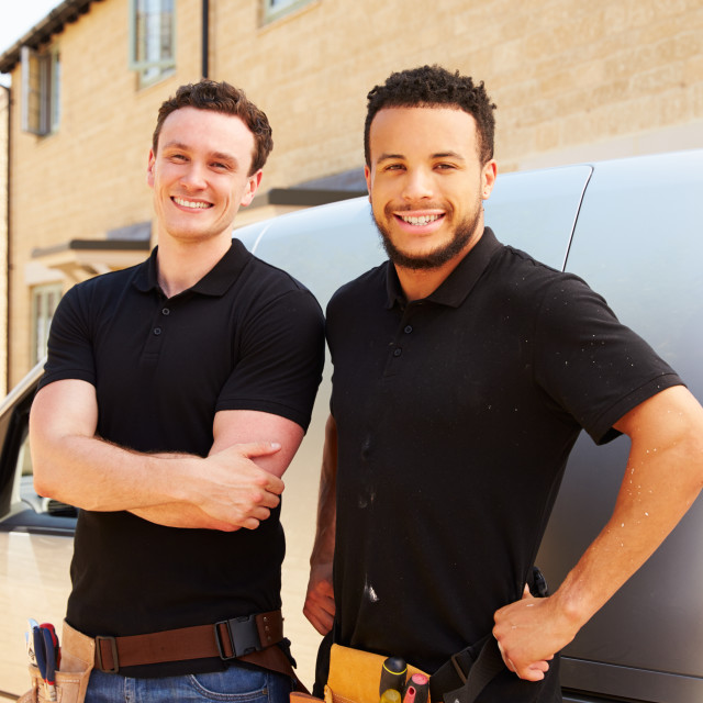 """""""Portrait of two young tradesmen by their van"""" stock image"""