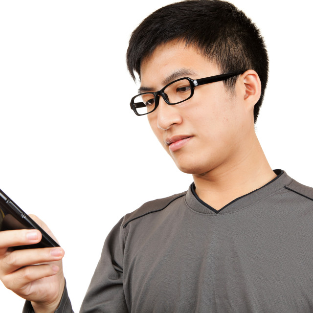 """man read SMS on cellphone"" stock image"