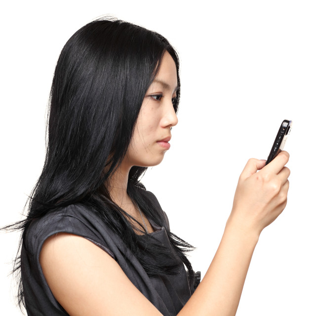 """girl read sms on phone"" stock image"
