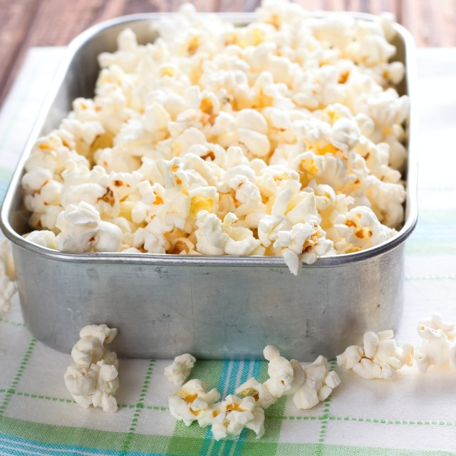 """Aluminum square bowl full of salt popcorn"" stock image"