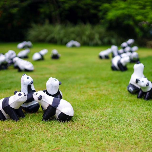 """Panda dolls on green field"" stock image"
